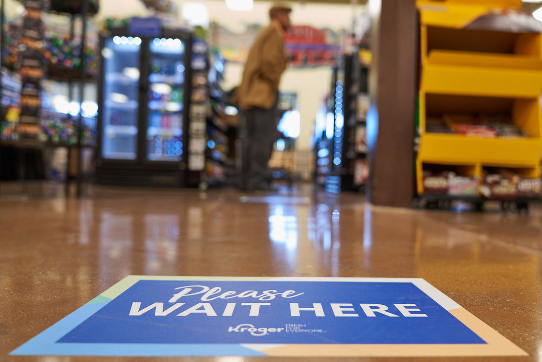 Kroger please wait here sign