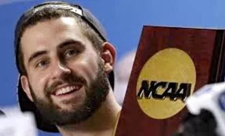 Luke Hancock with 2013 NCAA trophy