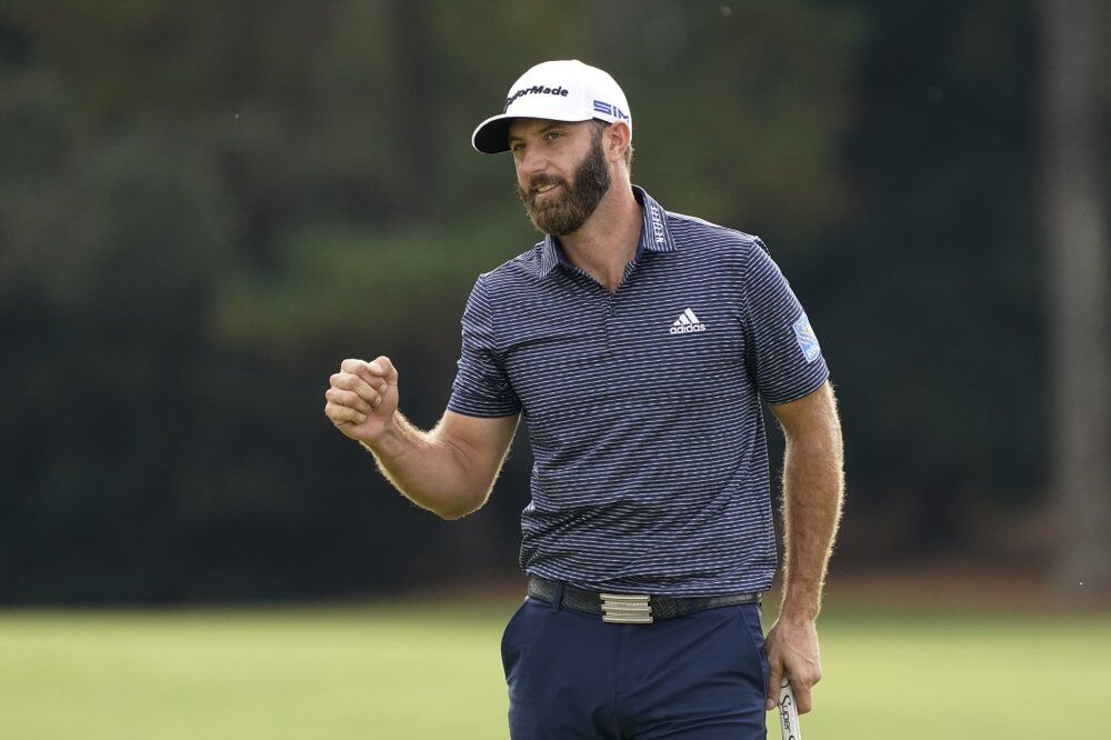 Dustin Johnson pumps his fist after wining the the Masters golf tournament