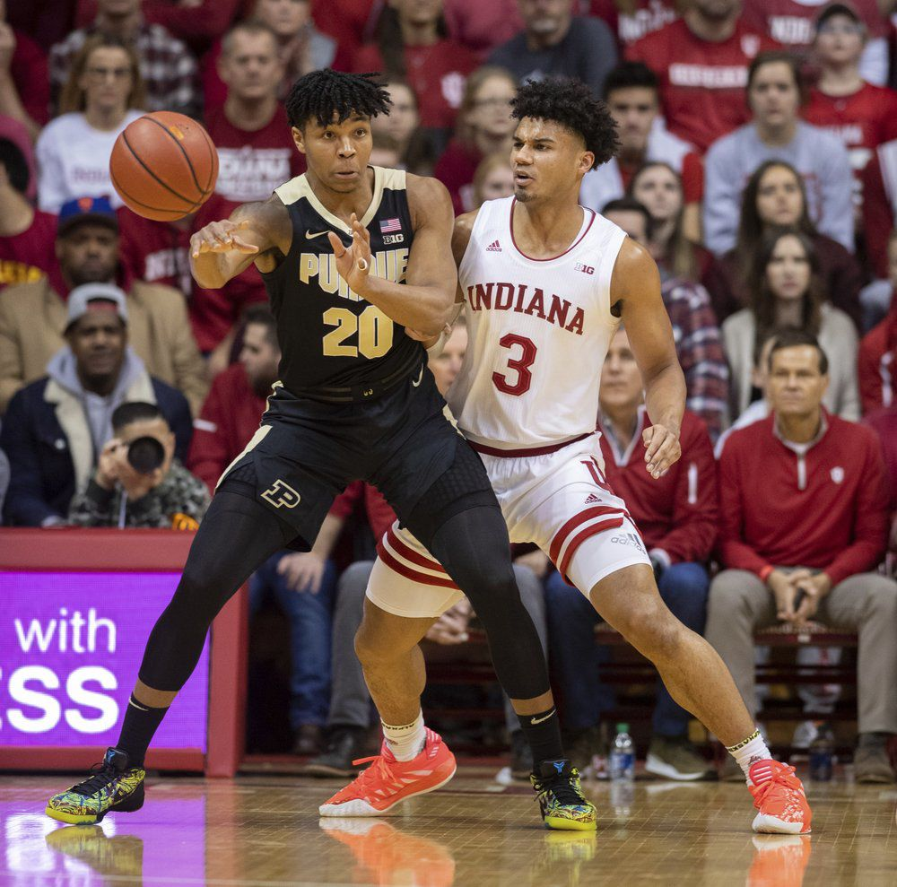 Purdue guard Nojel Eastern (20) makes a pass as Indiana forward Justin Smith