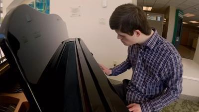 Norton piano player