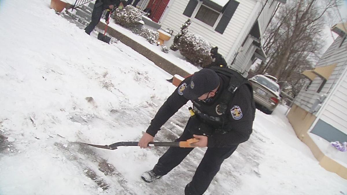 LMPD Officers Shovel Snow