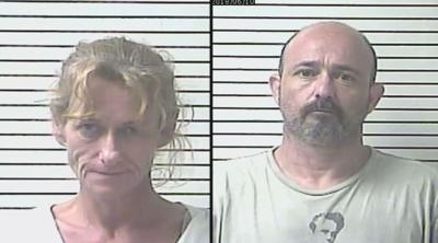 Hardin County couple charged with murder after man found buried in wooded area behind their home
