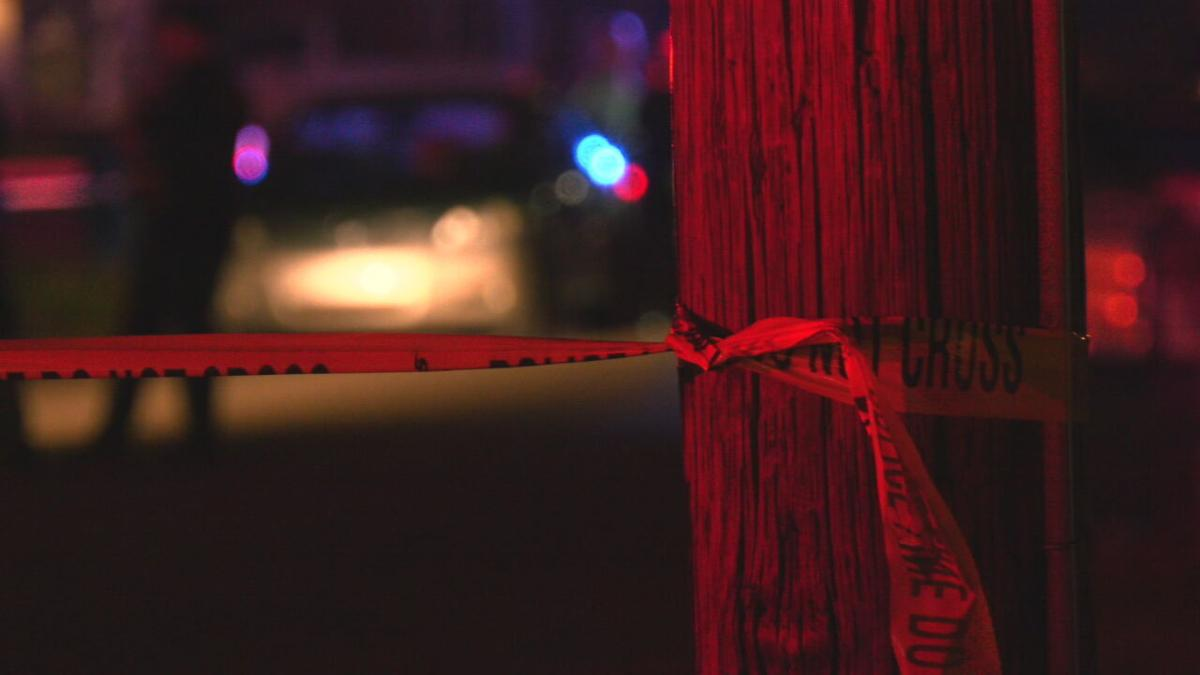 caution tape outside Newburg home after 9-year-old shot and killed