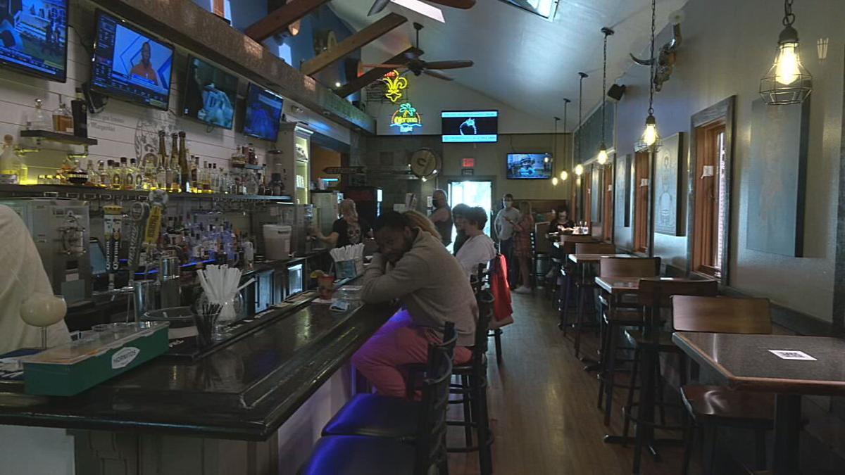 Patrons eating at a bar (generic)
