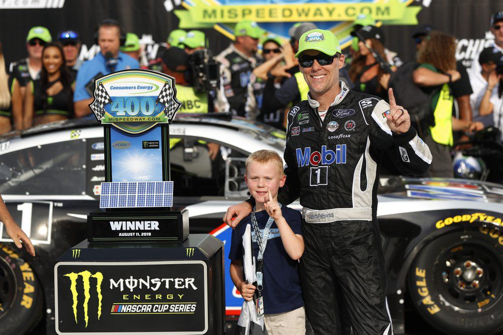 Kevin Harvick celebrates with his son, Keelan