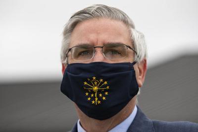 Gov. Eric Holcomb wearing mask with Indiana logo - 4-30-20-AP.jpeg