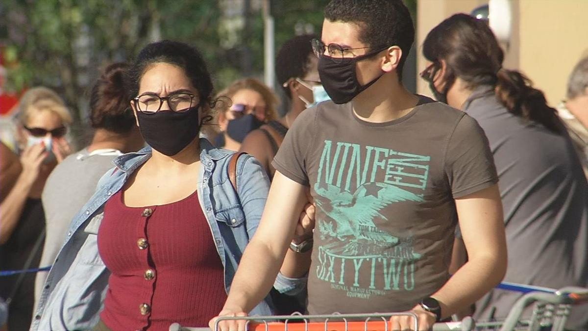 Customers wear masks at Louisville Walmart