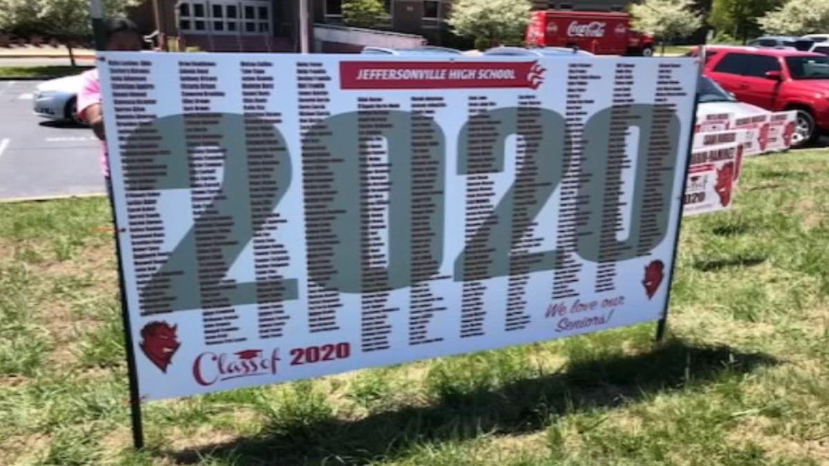 JEFF HS HONORS SENIORS WITH SIGNS (1).jpg