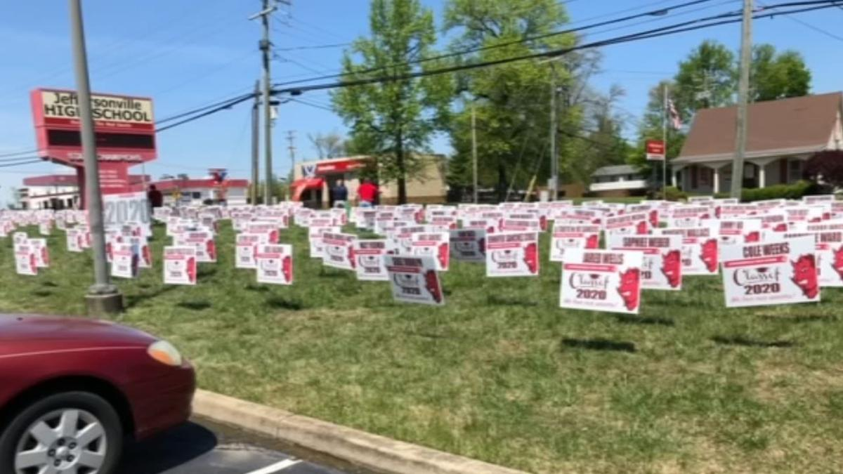 JEFF HS HONORS SENIORS WITH SIGNS.jpg