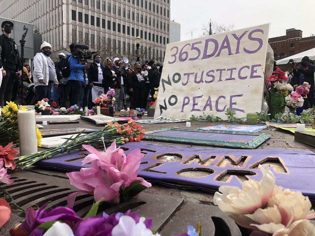 People gather Saturday, March 13, 2021, at Jefferson Square Park for rally marking anniversary of Breonna Taylor's death