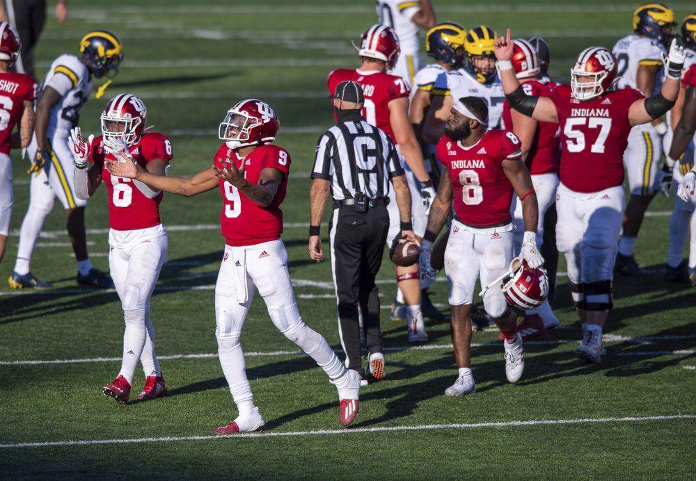 Indiana quarterback Michael Penix Jr. (9) and his teammates react
