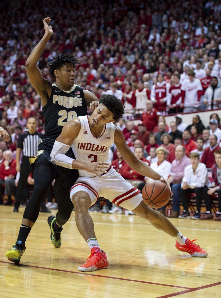 Indiana forward Justin Smith (3) makes contact with Purdue guard Nojel Eastern