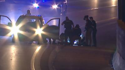 Police pull suspect from car after chase