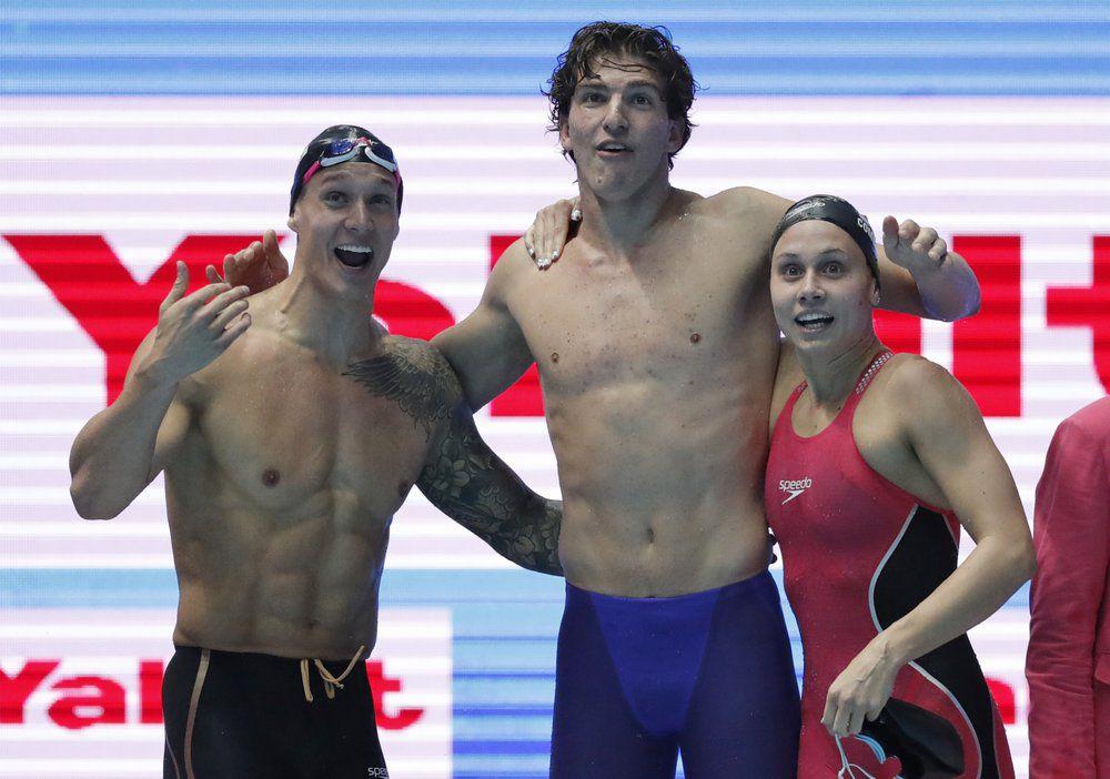 Caeleb Dressel, Zach Apple and Mallory Comerford celebrate