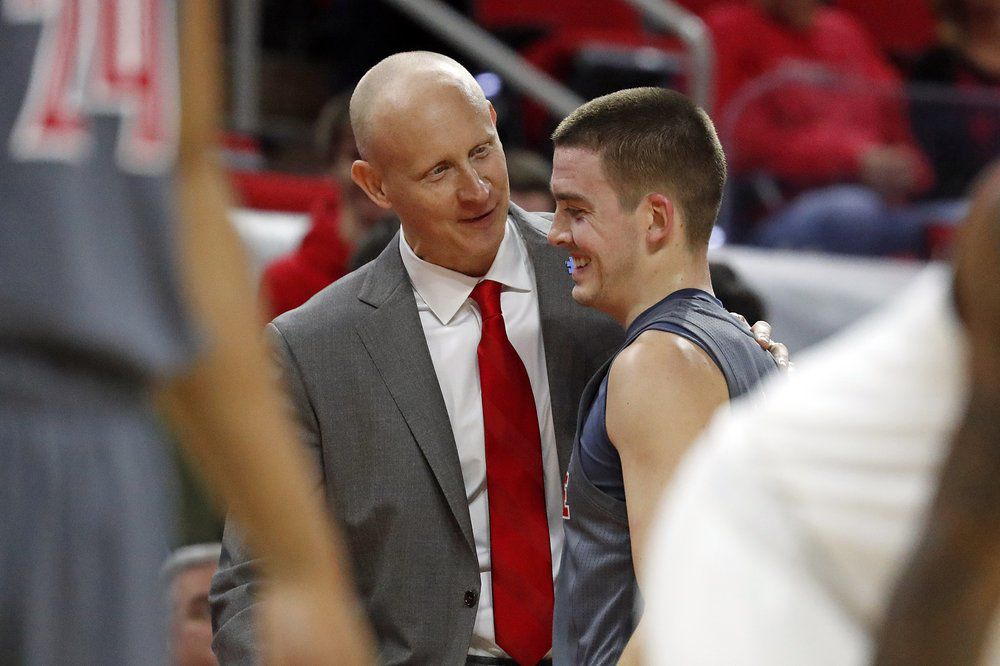 Louisville head coach Chris Mack congratulates Ryan McMahon