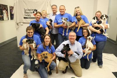 John Calipari hosts adoptable puppies at his office in response to U of L fan's sign