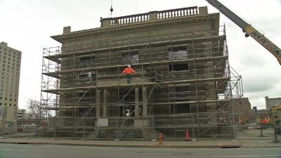 Old Water Company Building begins disassembly, heads to storage facility