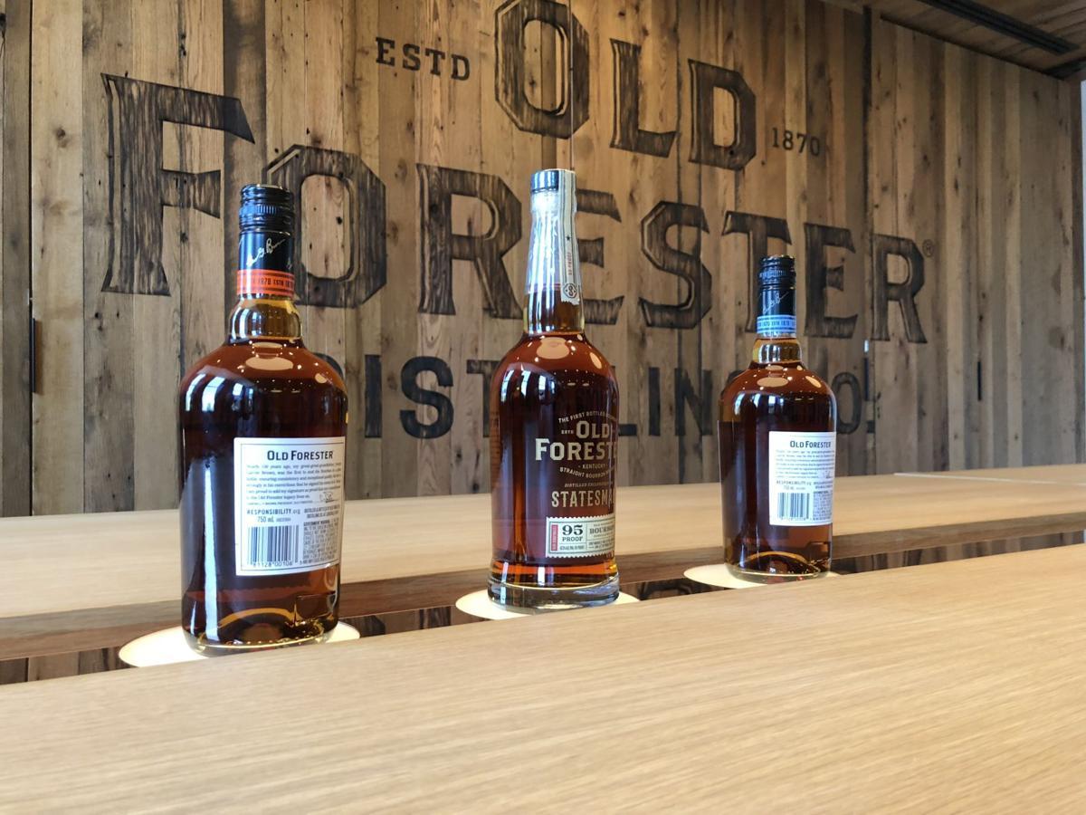 Old Forester distillery bottles on table