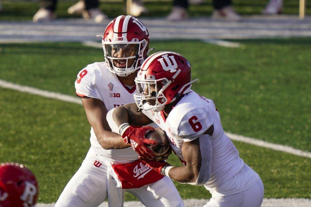 Indiana quarterback Michael Penix Jr. (9) hands off to running back Sampson James