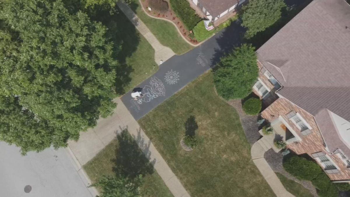 Louisville man transforms driveway into canvas for chalk work