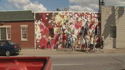 Local artists paint unique mural in Shelby Park neighborhood