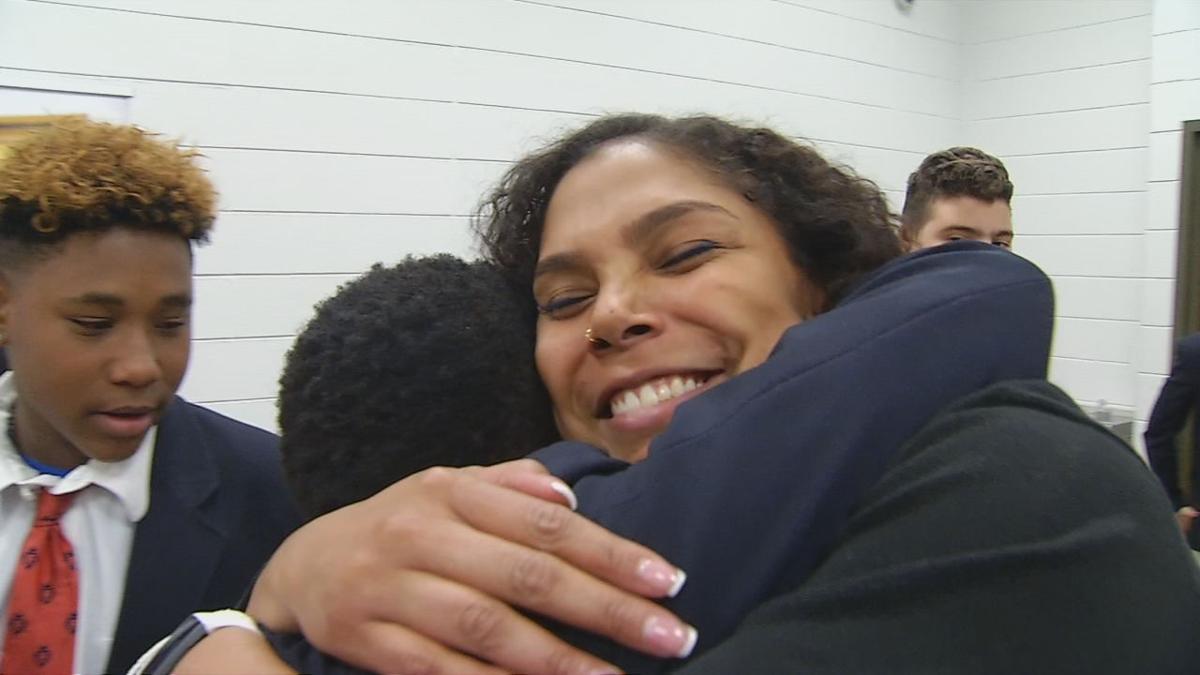 TEACHER TAKING KIDS TO DC 5pPKG.transfer_frame_10944 hug.jpg