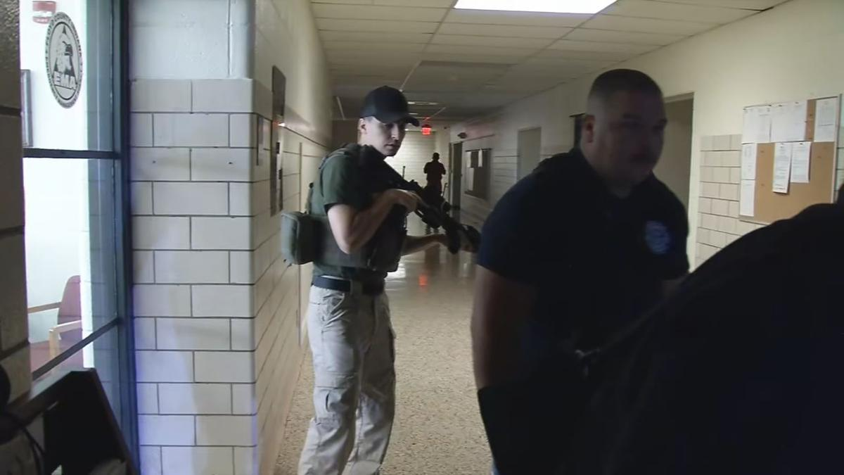 Floyd County Mass Shooting Situation - officers in hall