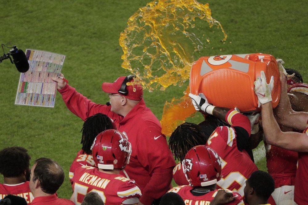 Kansas City Chiefs players pour Gatorade on head coach Andy Reid.jpeg