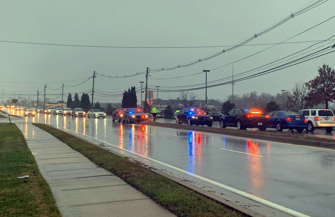 Police cars pulling into Deidre Mengedoht funeral
