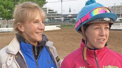 Sophie Doyle and her mom Jacqui on the backside at Churchill Downs