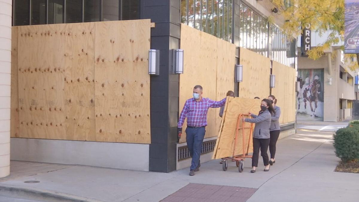Plywood being removed from Marriott Louisville (Oct. 2020)