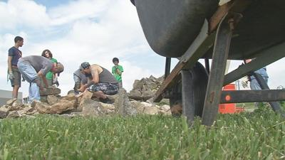 Volunteers help clean up historic southern Indiana cemetery in honor of Memorial Day