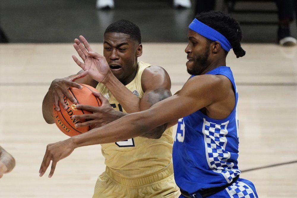 Georgia Tech forward Moses Wright, left, and Kentucky forward Isaiah Jackson