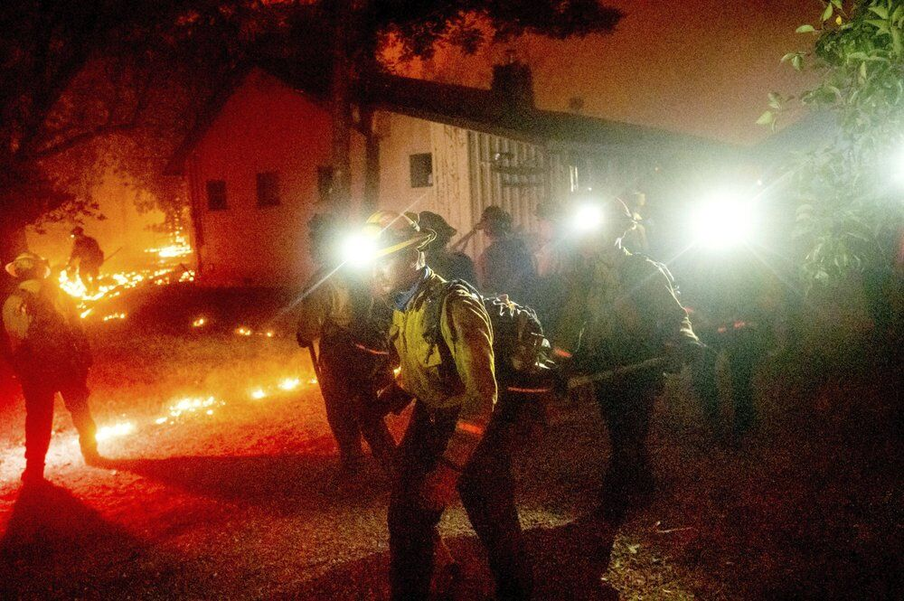 California Wildfires - Crew works to save home as Bear Fire burns in Butte County