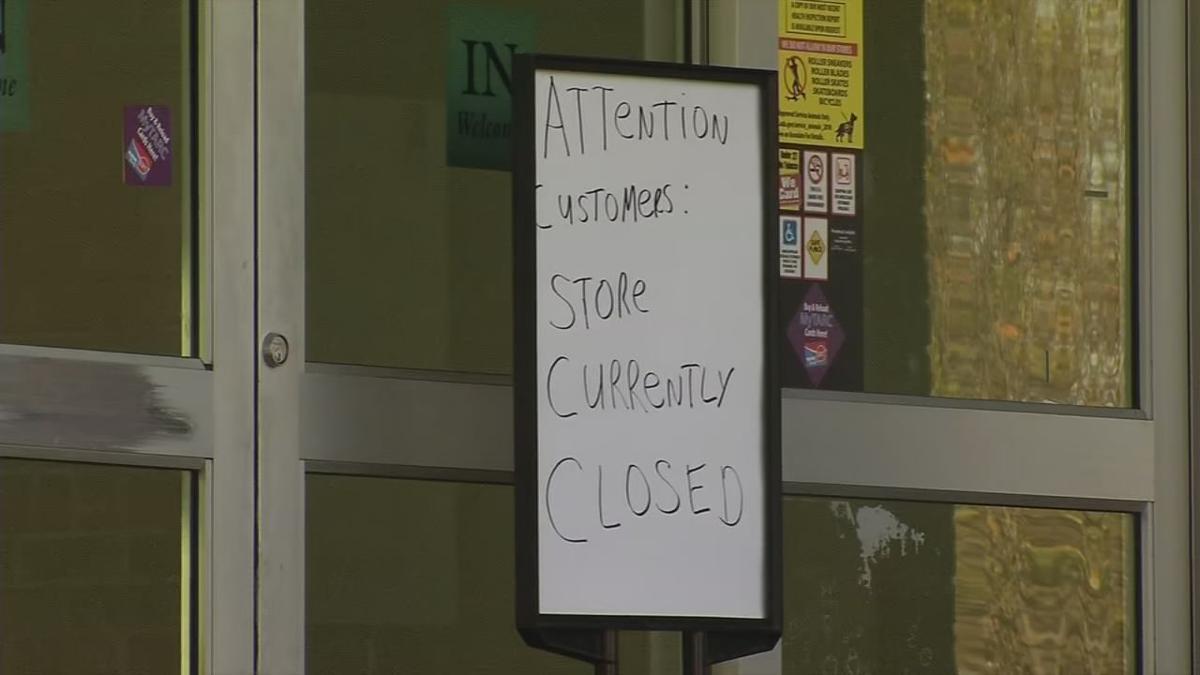 Closed sign on Kroger store in Portland neighborhood