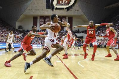 Indiana guard Devonte Green (11) drives in front of Ohio State guard Luther Muhammad