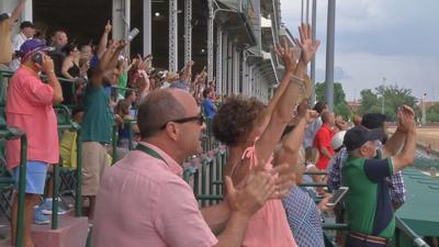 Churchill Downs crowd cheers on Justify as he becomes 13th Triple Crown winner at 150th Belmont Stakes