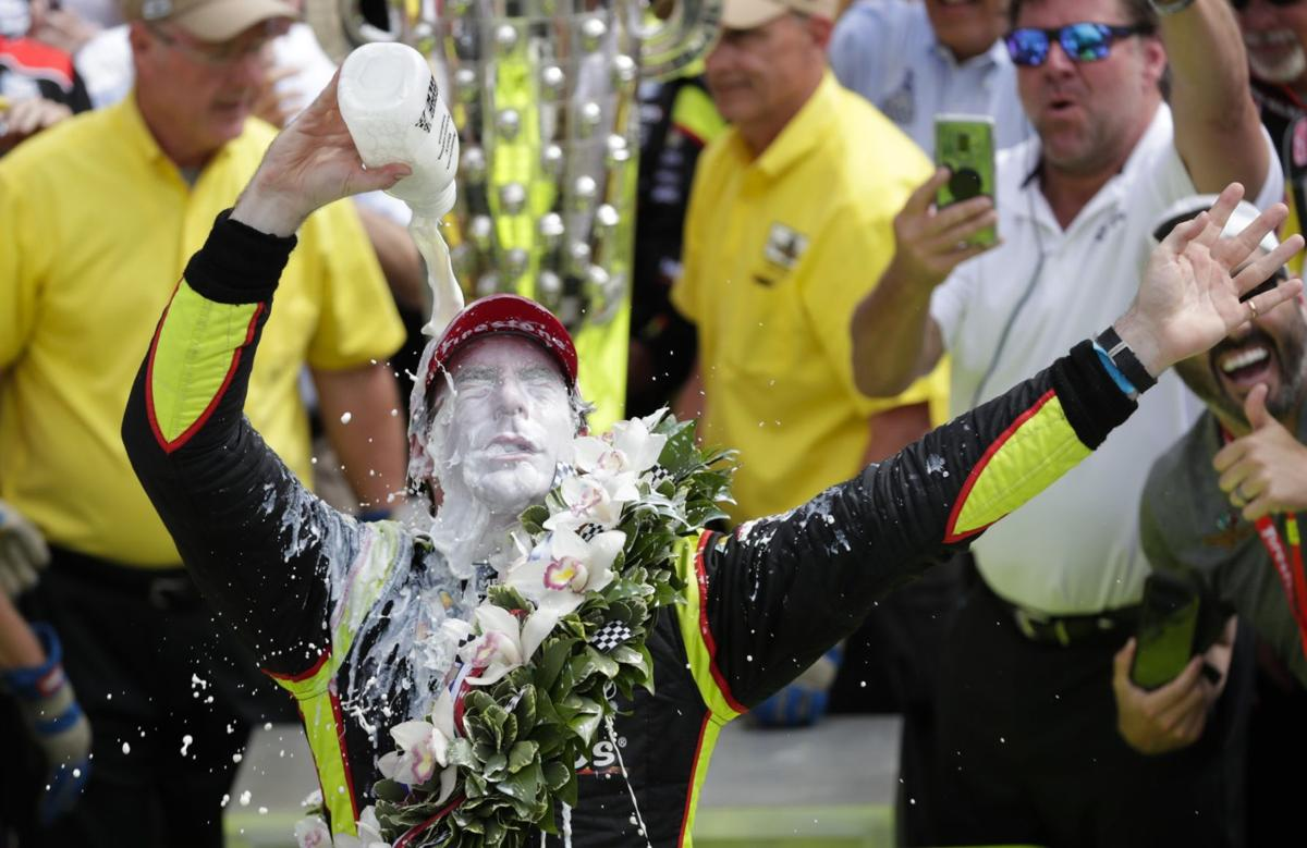 Simon Pagenaud celebrates after winning the Indianapolis 500