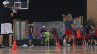 FEAT of Louisville partners with former Card Luke Hancock for basketball clinic