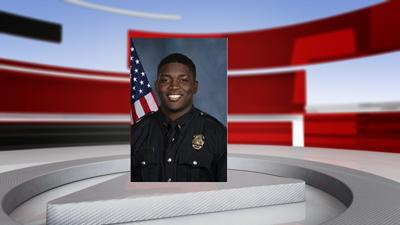 Officer Robinson Desroches background.png