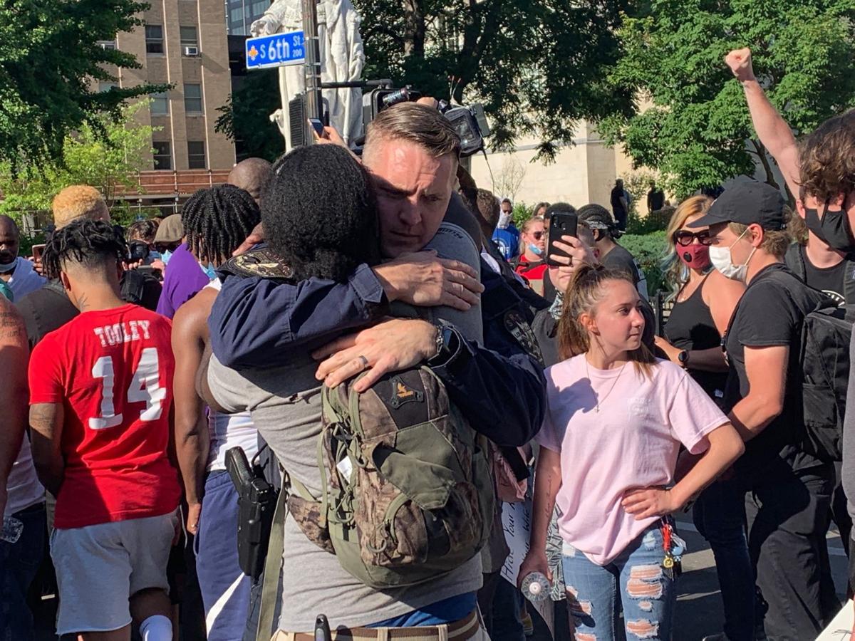 LMPD officer hugs protester-6-1-20.JPG