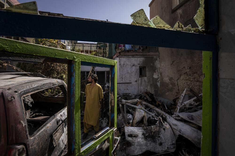 Afghan inspects rubble in Kabul