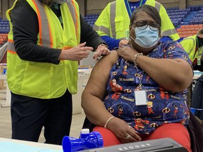 Bobbie Lester vaccine JCPS Broadbent Arena.jpg