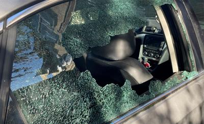 Shattered car window after several shots fired near Hess lane on April 3, 2021