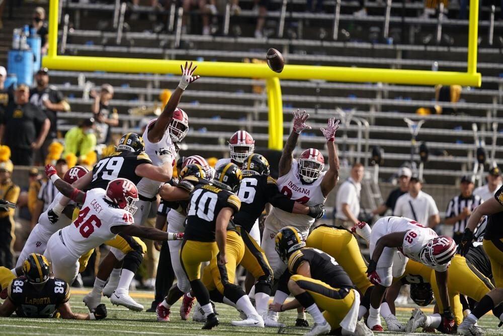Iowa place kicker Caleb Shudak kicks a fied goal against Indiana.jpeg
