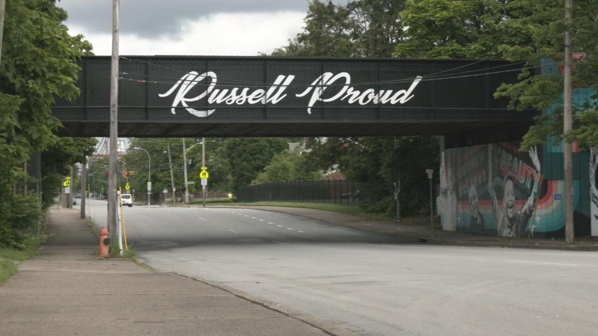 Russell Proud Sign.