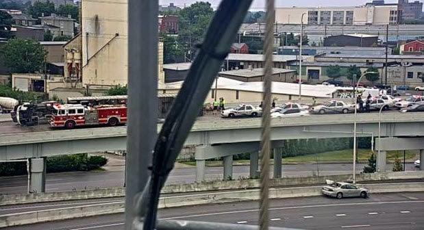 Overturned Semi hauling pigs on I-64S ramp