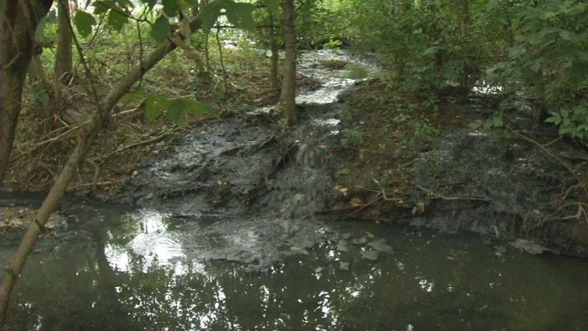 Sewage runoff after collapse of sewage treatment plant in Hunters Hollow, Kentucky