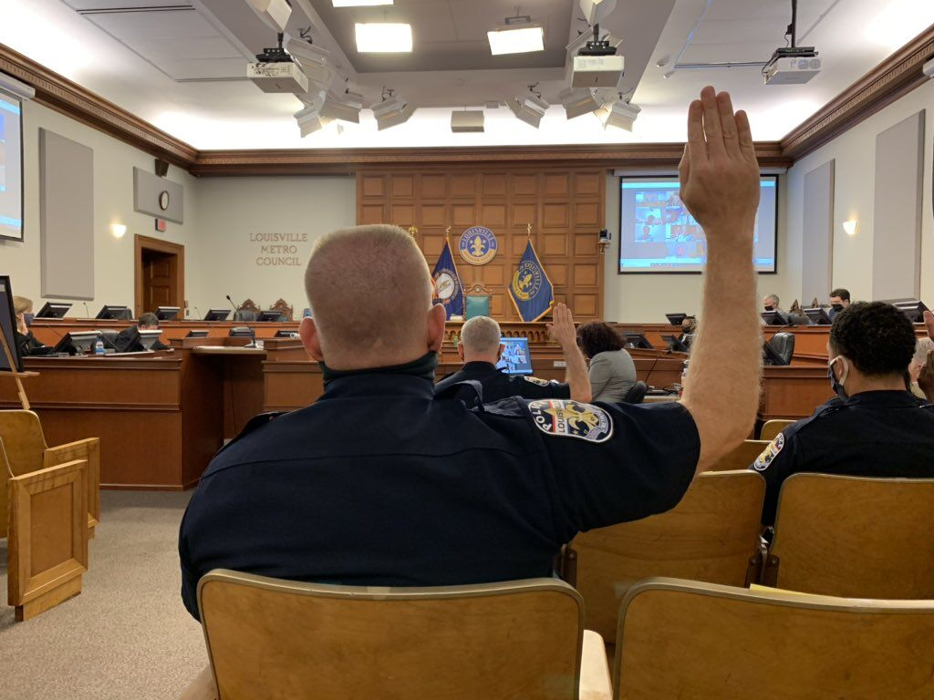 LMPD officers raise their right hands before testifying in front of a Metro Council committee